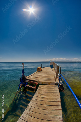 Poster Turquoise Wooden pier on Transparent waters of Lake Sevan of Armenia