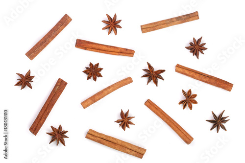 Fototapeta Composition of star anise and cinnamon sticks isolated on white. Abstract pattern flat lay, top view obraz