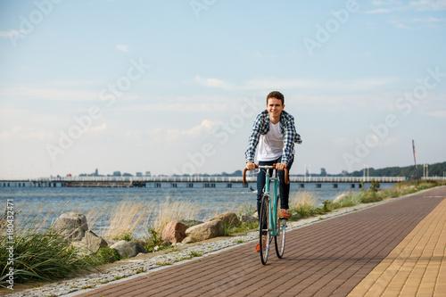 Staande foto Fiets Young man biking