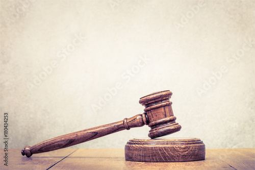 Retro auction or judge wooden gavel on table Wallpaper Mural