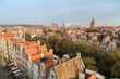 View of old residential buildings at the Main Town (Old Town), St. Cathrine's Church and beyond in Gdansk, Poland, from above in the morning.