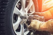 Car Mechanic Worker Doing Tire...