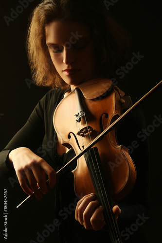 Spoed Fotobehang Muziek Violin player. Violinist playing violin