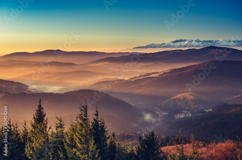 Foto auf Gartenposter Gebirge panorama over misty Gorce to snowy Tatra mountains in the morning, Poland landscape