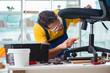 Furniture repairman working on repairing the chair