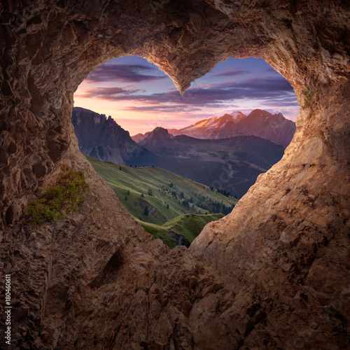 View from heart shape cave to the idyllic mountain scenery
