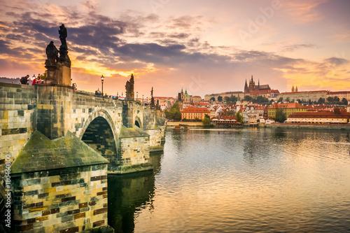 Photo Stands Prague Charles Bridge in Prague and Prague Castle at sunset, Prague, Czech Republic in autumn