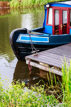 Blue And Red Canal Boat Moored...