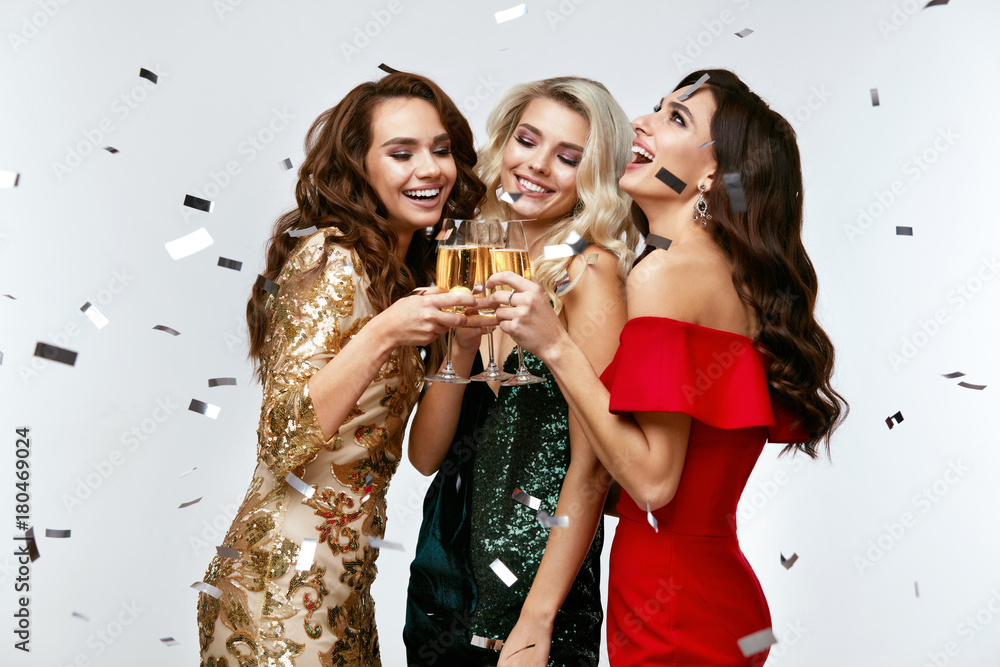 Fototapeta Beautiful Women Celebrating New Year, Having Fun At Party