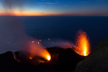 Lava Fountain On The Summit Of The Erupting Volcano Stromboli, Italy, At Sunset.