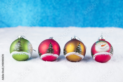 Group of colorful Christmas balls on a white snow background