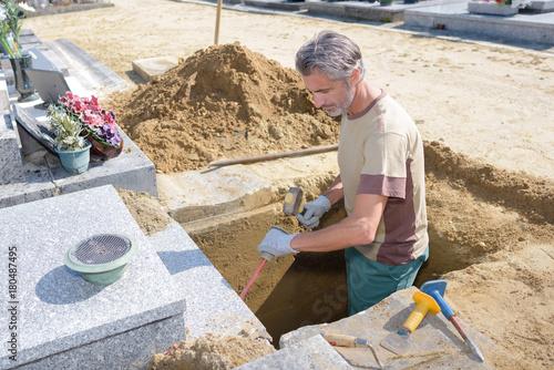 digging a grave Canvas Print