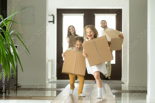 Canvastavla  Happy family with kids bought new home, excited children funny girl and boy hold