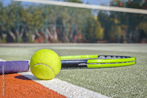 macro tennis ball and racket on hard court Poster