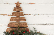Vintage Wooden Christmas Tree On Old Rustic Wooden White Background.