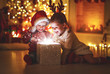 canvas print picture Merry Christmas! happy children with magic  gift  at home