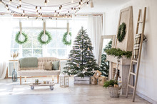 New Year And Christmas 2018. Beautiful, Bright, Spacious, Decorated, Christmas Apartment With A Fireplace, A Large Beautiful Tree And A Huge Window.