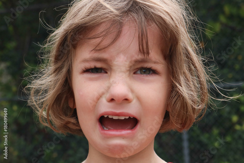 Fotografering  Portrait of a young girl who is very angry and upset