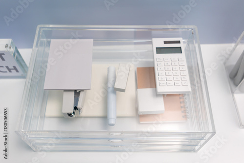 Fotografia Stationery items in transparent acrylic glass organizer with drawers