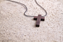 Wooden Cross Necklace On A Stone