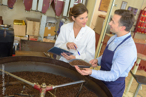Papiers peints Café en grains coffee roasting process with alchemist and scientist
