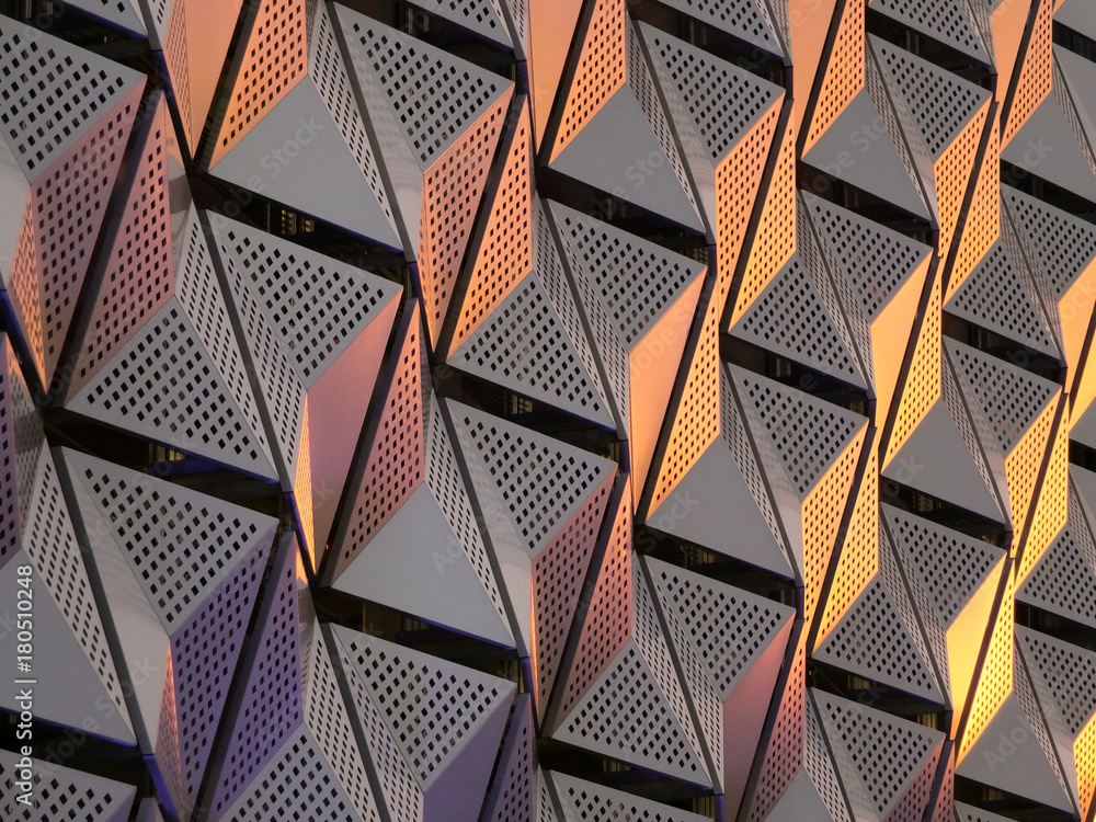 Fototapeta modern steel angular geometric cladding with colour tones and perforated patterned design