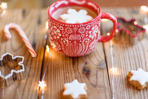 Spoed Foto op Canvas Chocolade Cozy cup of hot cocoa with snowflake shaped marshmallow