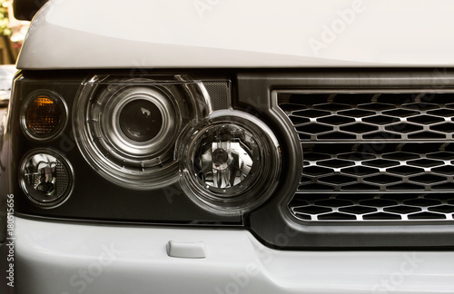 Suv car headlight photo with mesh grille. Canvas Print