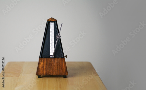 Metronome in action, closeup, isolated and on a plain background Canvas Print