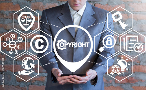 Copyright Information Technology Business concept. Man using smartphone with copyright gear icon on a virtual interface.