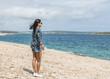 woman on the beach by Pula Croatia
