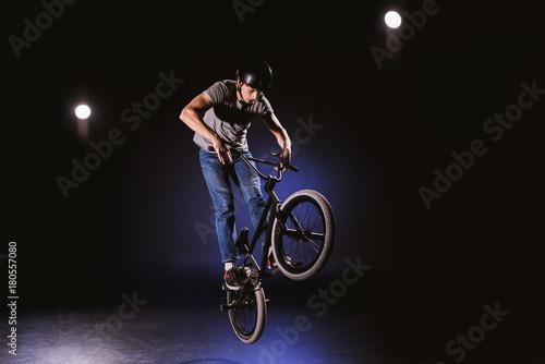 bmx cyclist performing stunt Canvas Print