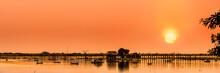 The Silhouette Of U Bein Bridge, The Oldest And Longest Teakwood Bridge In The World Across The Taungthaman Lake, Amarapura, Myanmar