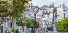 SAN FRANCISCO - AUGUST 6, 2017: Beautiful City Skyline With Steep Street. The City Attracts 20 Million People Annually