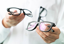 Optician Comparing Lenses Or S...