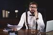 Businessman receiving bad news while phone call