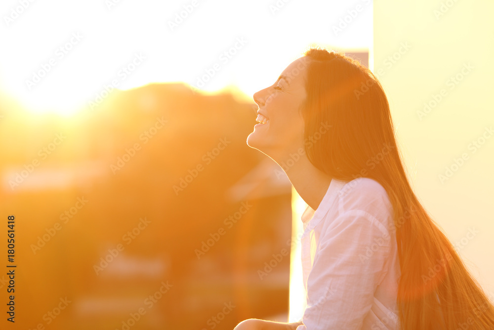 Fototapety, obrazy: Woman breathing at sunset in a balcony