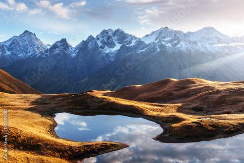 Fotografia  Sunset on mountain lake Koruldi