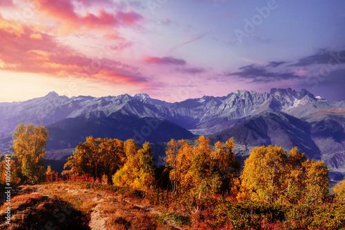 Tuinposter Purper Autumn landscape and snow mountains in beautiful cumulus clouds. Main Caucasian Ridge. Type Mount Ushba Mheyer, Georgia