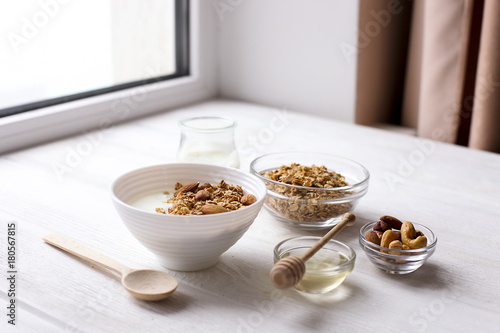 Healthy breakfast granola with nuts on window sill at home