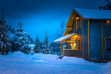 Snow-covered Cottage. Wooden T...