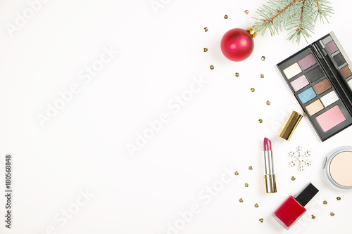 Fototapeta Make up cosmetic with Christmas decoration on white background flat lay obraz na płótnie