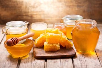 Fototapeta various types of honey in glass jars
