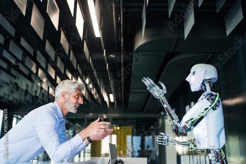 Fotografia, Obraz  Mature businessman or a scientist with robot.