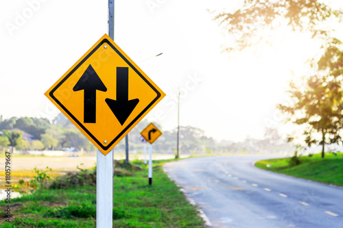 two-way traffic Signs on road with soft-focus and over light in the background Canvas-taulu