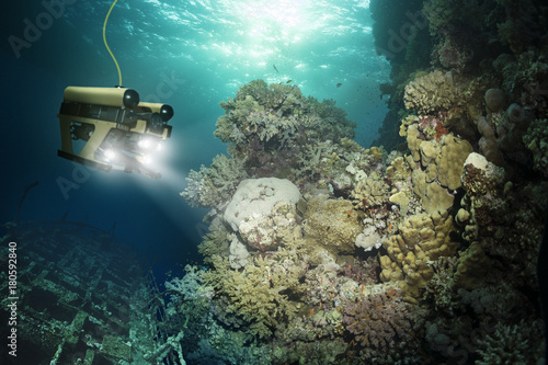 Foto op Canvas Schipbreuk Robot inspects a sunken ship deep under water