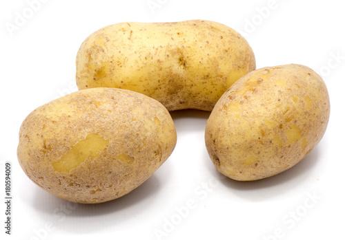 Fotografie, Obraz  Three whole potatoes isolated on white background.