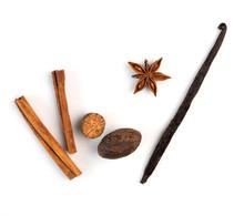 Cinnamon, Nutmeg And Vanilla On A White Background