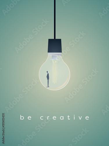 Obraz Business creativity vector symbol with businessman standing in lightbulb. - fototapety do salonu