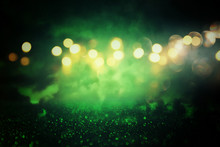 Green Glitter Vintage Lights Background. De-focused.
